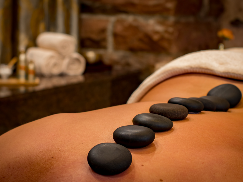 person getting hot stone massage